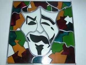 Eigen ontwerp van de klant, geheel brand schilderwerk ook de puzzel stukjes, deels gevat in lood.