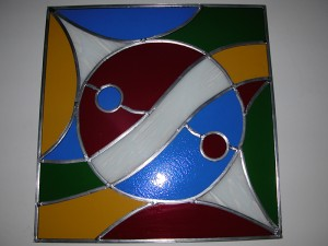 Ontwerp door de klant, gekleurd glas in lood. Yin en yang.