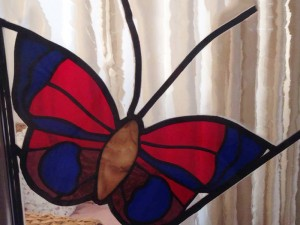 vlinder vliegt bijna weg...