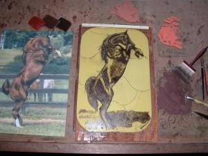paradepaard op ontwerptafel, kleurtjes uit proberen.