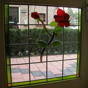 roosmotief in buitendeur, eigen ontwerp