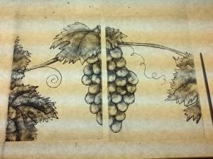 tweede proces in het brandschilderen: de schaduw opbrengen, druiven